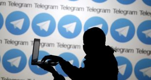 A man poses with a laptop in front of a screen showing the Telegram logos in this picture illustration taken in Zenica, Bosnia and Herzegovina November 18, 2015. The mobile messaging service Telegram, created by the exiled founder of Russia's most popular social network site, has emerged as an important new promotional and recruitment platform for Islamic State. The service, set up two years ago, has caught on in many corners of the globe as an ultra-secure way to quickly upload and share videos, texts and voice messages. It counts 60 million active users around the world. Picture taken November 18.      REUTERS/Dado Ruvic####################DADO RUVIC